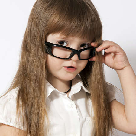 portrait of the little girl wearing glasses