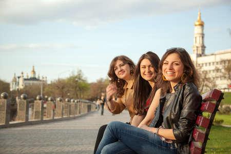kharkov: Girls sitting on a bench in city park