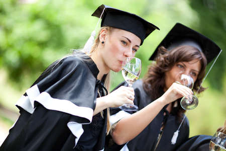 mantles: Bachelor graduates celebrate with a glass of white wine in mantles