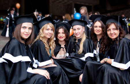 A group of girls in gowns of graduates photo