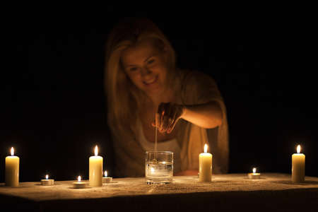 The girl guesses with candles in the dark