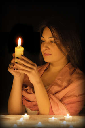 Beautiful girl with a candle in the dark Stock Photo - 14748893
