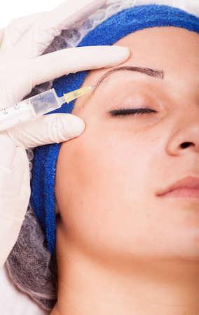 young girl getting Botox injection procedure photo