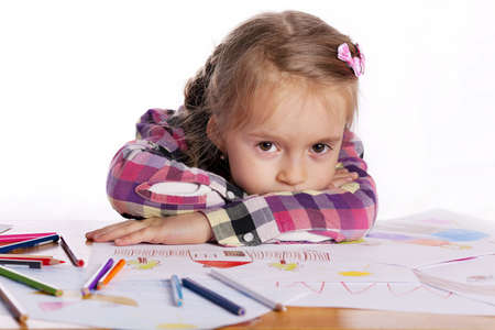 weariness: A tired child - an artist with a sketch and colored pencils in a checkered shirt on a white background