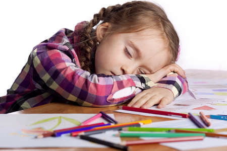 Sleeping child - an artist with sketch and colored pencils in a checkered shirt on a white background photo