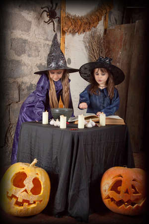 two little witches conjure in an abandoned house photo
