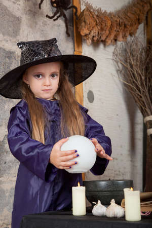 bewitchment: Little witch with magic sphere