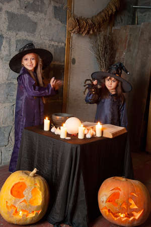 bewitchment: two little witches conjure in an abandoned house