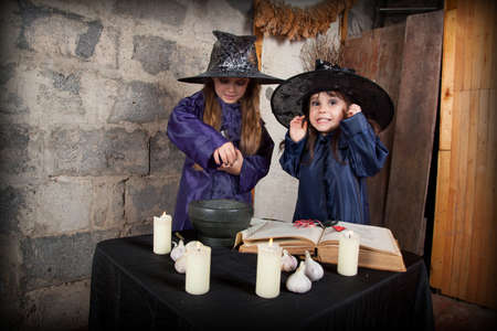 witchery: two little witches conjure in an abandoned house