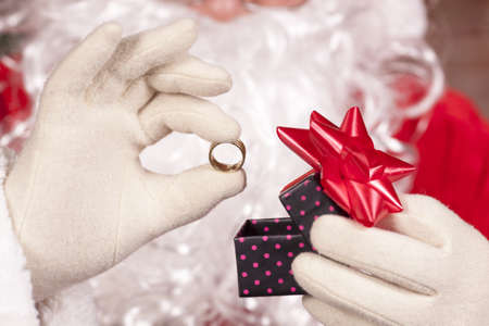 Jewelry ring gift Santa Claus under the Christmas tree photo