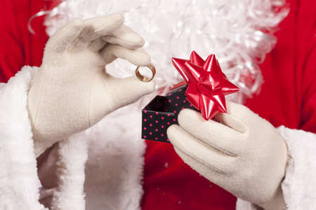 Jewelry ring gift Santa Claus under the Christmas tree