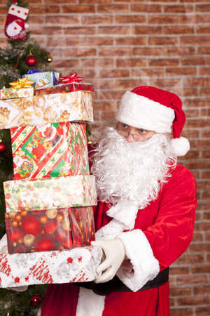 felicitation: Santa Claus brings Christmas gifts near the Christmas tree