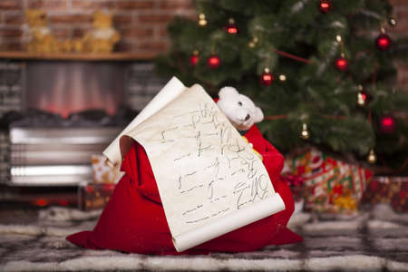 Bag of Santa Claus with gifts and cristmas list