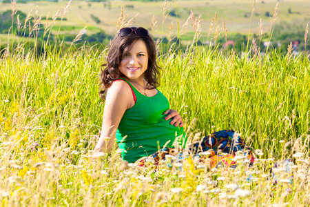 portrait of a beautiful pregnant woman in the countryside