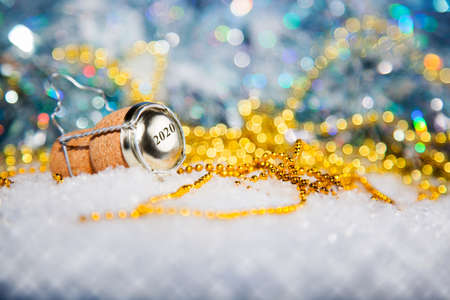 champagne cork: New Years EveChampagne cork  in the snow new years 2020 Stock Photo