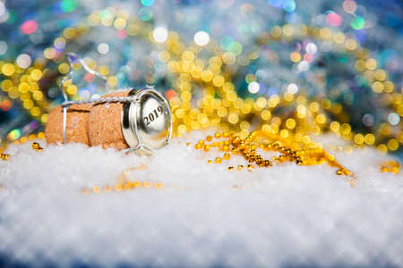 champagne cork: New Years EveChampagne cork  in the snow new years 2019