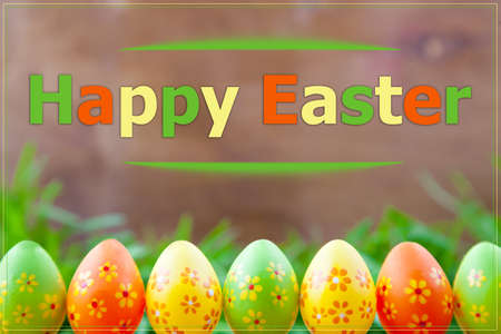 Colored Easter eggs on grass background card