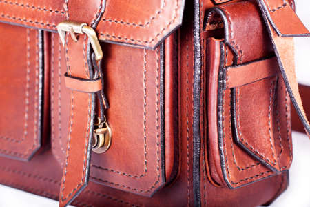Metal buckle clasp on leather briefcase