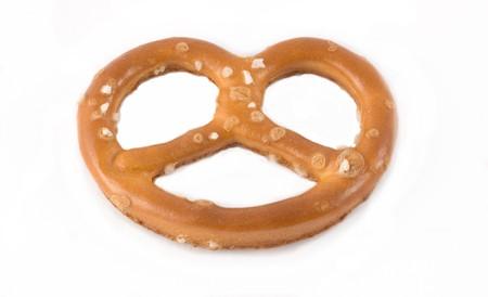 caloric: Single pretzel isolated on white