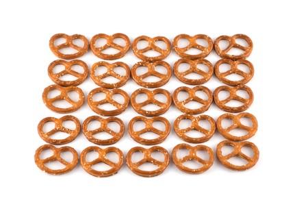 caloric: Many of pretzels isolated on white