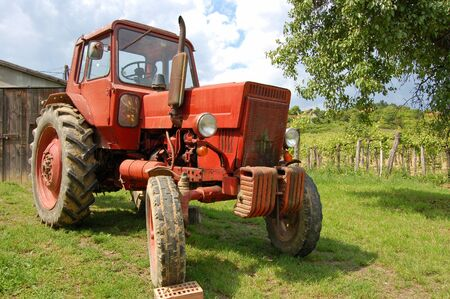 Old red tractor in the vineyard Stock Photo