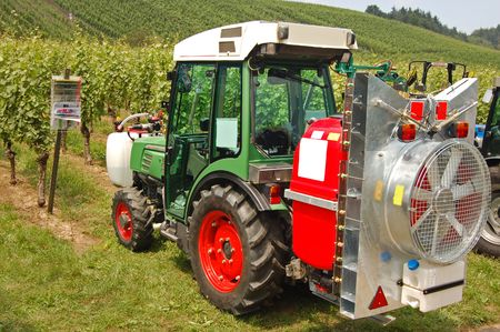 Spray machine on the tractor in the vineyard photo