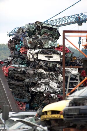 Junkyard with the pieces of destroyed cars Stock Photo - 5320795
