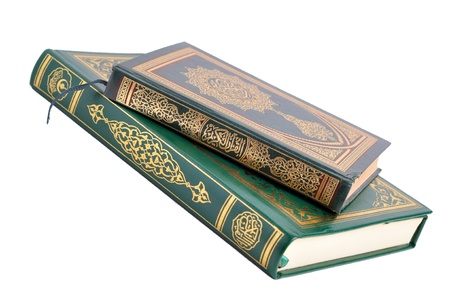 Two books of the holy Quran isolated on white photo