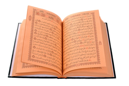 The Holy Book Of Quran Isolated On White photo