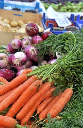 Fresh Carrots And Red Onions At The Local Market photo