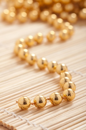 pearl necklace: Gold pearls with shallow depth of field