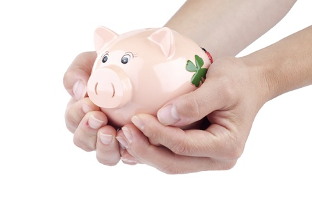 lend a hand: Protecting money in a piggy bank