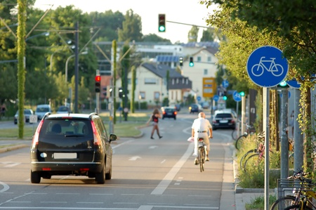 Cyclist passing by at an urban cycle path photo