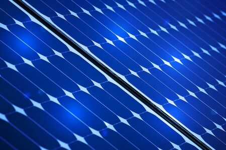 Blue Photovoltaic solar panel With Lights On It photo