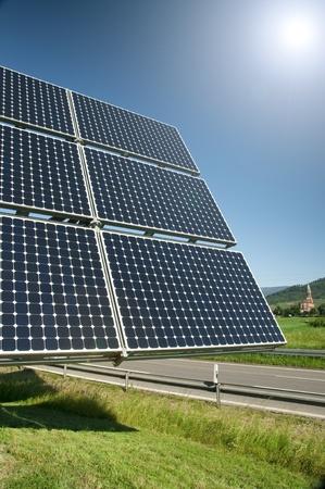 Solar Panel With The Sun Against The Blue Sky