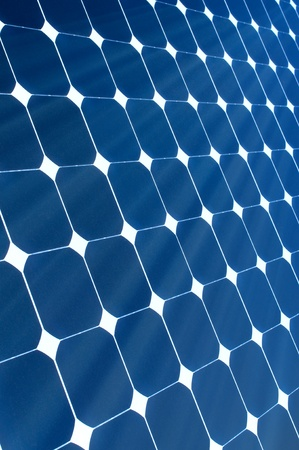 The Sun is shining onto a Blue Solar Panel photo