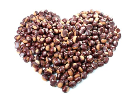 Heart Symbol made of chestnuts isolated on white photo