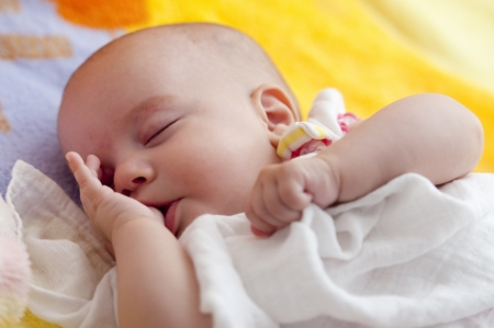Adorable Baby Girl is sleeping in the bed photo