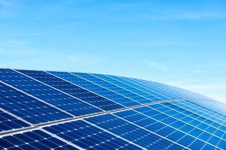 Solar Panels Against The Deep Blue Sky photo
