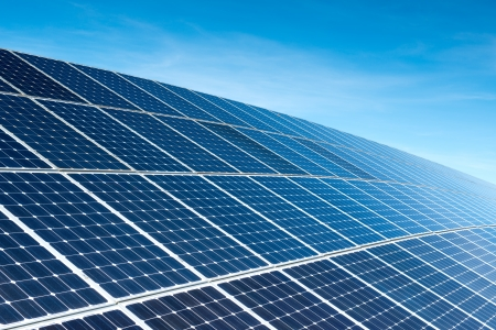 electric cell: Solar Panels Against The Deep Blue Sky Stock Photo