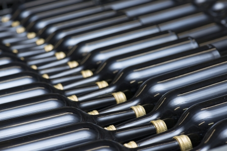 Many of Wine Bottles In A Row photo
