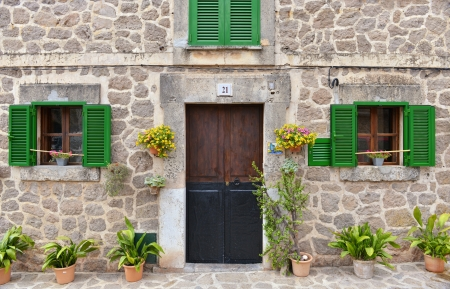 spanish house: Typical Mediterranean Village with Flower Pots in Facades in Valldemossa, Mallorca, Spain ( Balearic Islands )