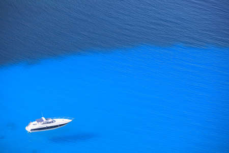 billow: Lonely Yacht in the Open  Sea View From Above Stock Photo