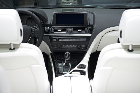 Modern Car Dashboard With White Leather Frontal Seats photo