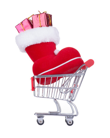 Shopping Cart With a Red Christmas Boot Isolated On White photo