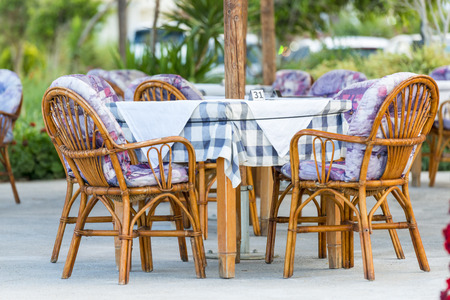 Nice Tables And Chairs In A Greek Tavern in Georgioupolis, Island of Crete, Greece photo