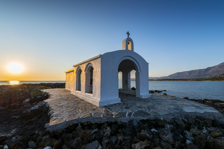 Small White Church By Sunrise in Georgioupolis, Crete, Greece photo