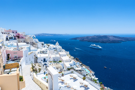 hotel balcony: View To The Sea And Volcano From Fira, The Capital of Santorini,  Island In Greece Stock Photo