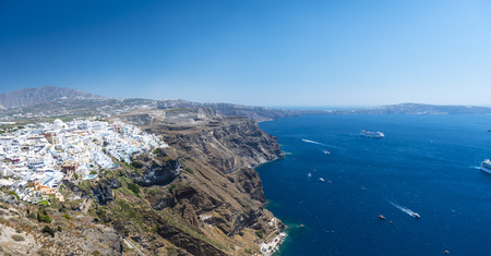 Beautiful View To The White Village of Fira In Santorini, Greece photo