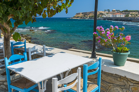 Table And Chairs In A Typical Tavern By The Sea At Rethymnon, Crete, Greece photo